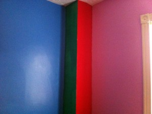 Southwest corner of The Nipper's room. Pink, red, green, and blue.