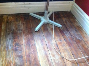 The Captain's floor after having been sanded and washed.