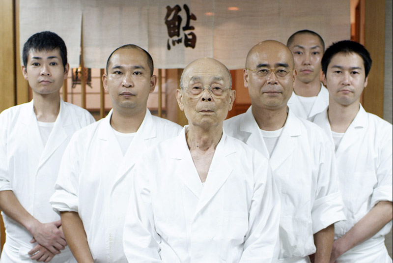 Jiro Dreams of Sushi photo featuring Jiro and his restaurant workers.