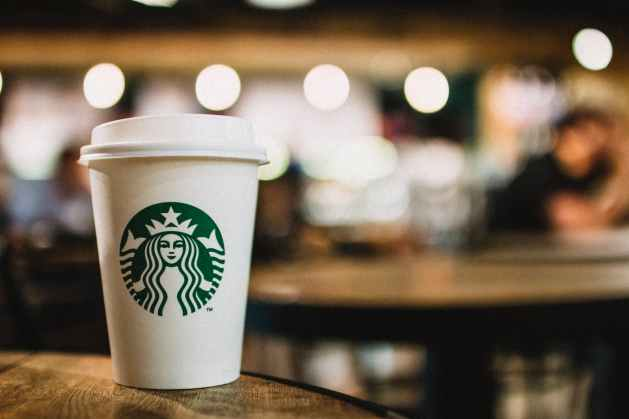 close up photography of starbucks disposable cup