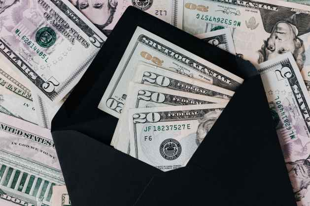 set of black opened envelope and cash dollars