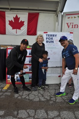 Lois Brown poses with participants by the memory board at the Terry Fox Run in Newmarket.