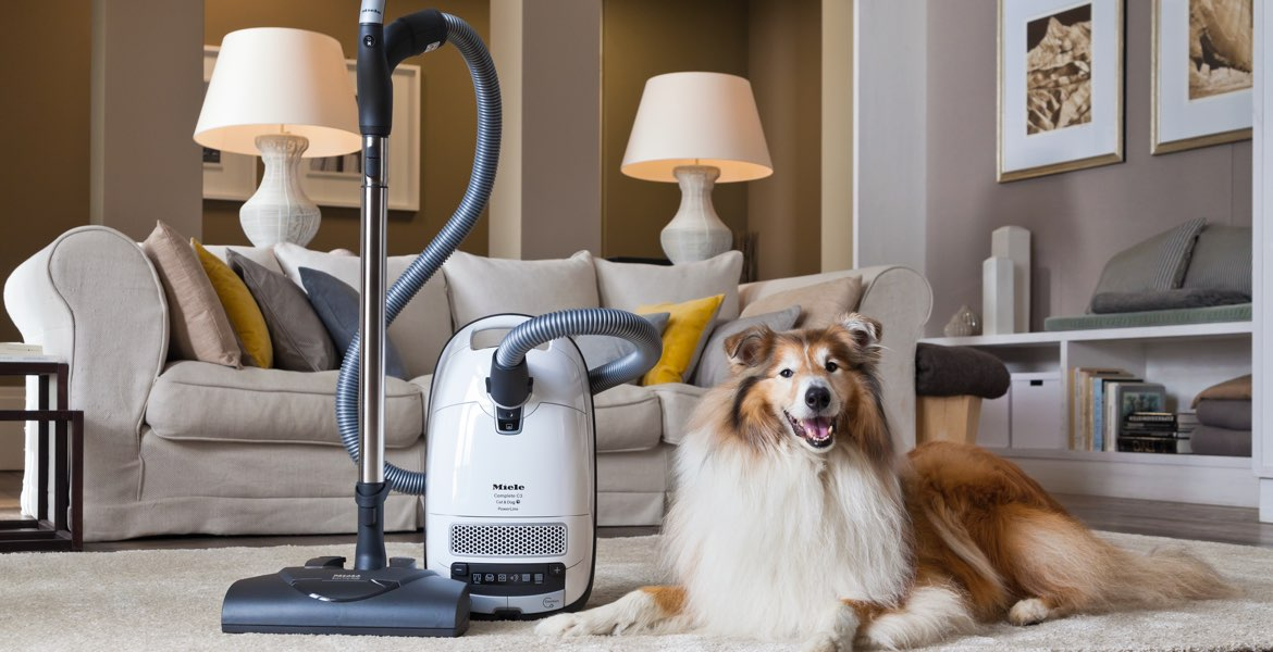 Miele Complete C3 Cat & Dog Canister Vacuum Cleaner dog and vacuum white