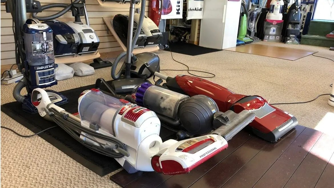 Shark vacuum next to a Miele upright vacuum and a Dyson Animal bagless vacuum cleaner. Shark vacuum cleaner repair, Shark vacuum sales, trade-ins welcome!