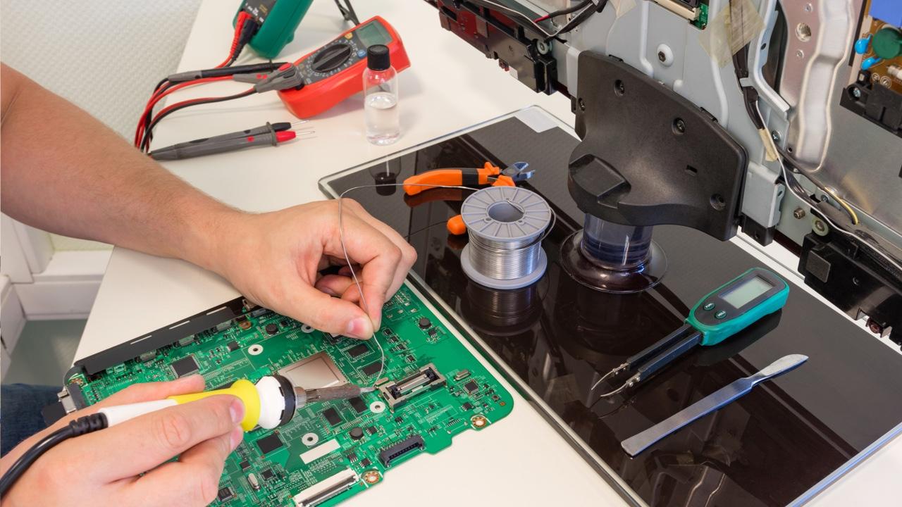 tech repairing a TV