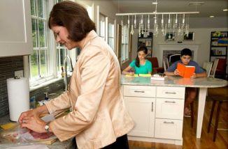 kids doing homework in the kitchen