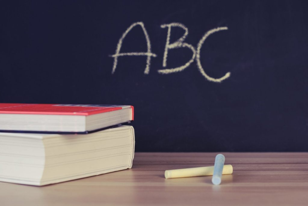 "blackboard with ""ABC"" written on it"