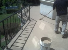 Rolling out the sealer to finish the deck