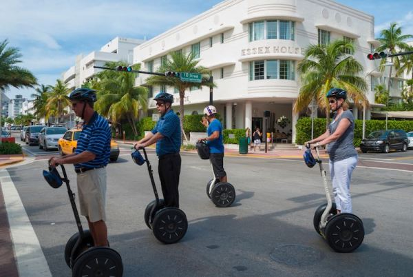 Group of tourists taking a turn on a street in Florida