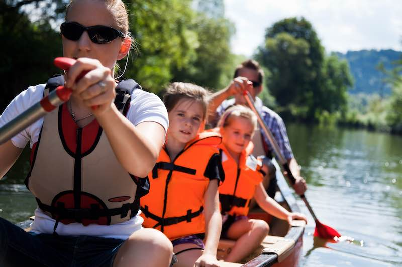 Family canoeing on a river in Central Florida. Canoe Rental in Central Florida