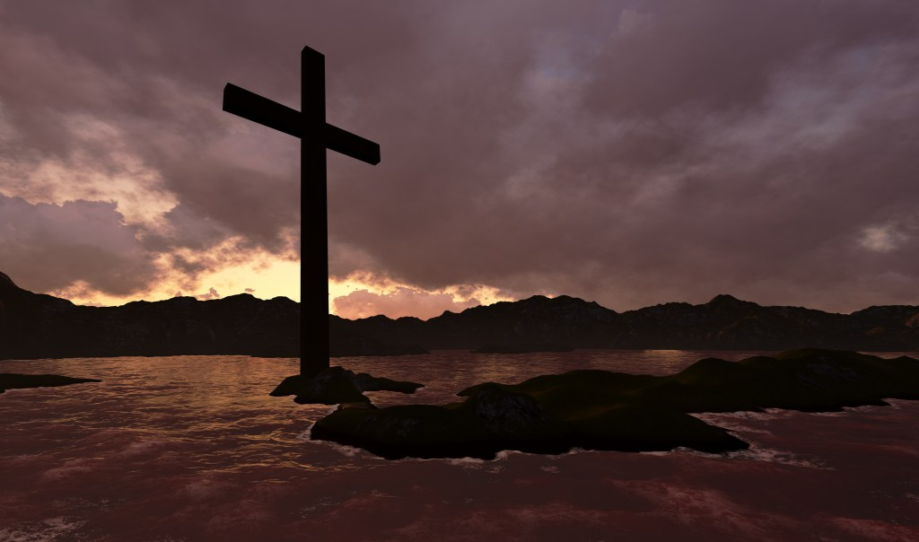 Cross in water with light sky background