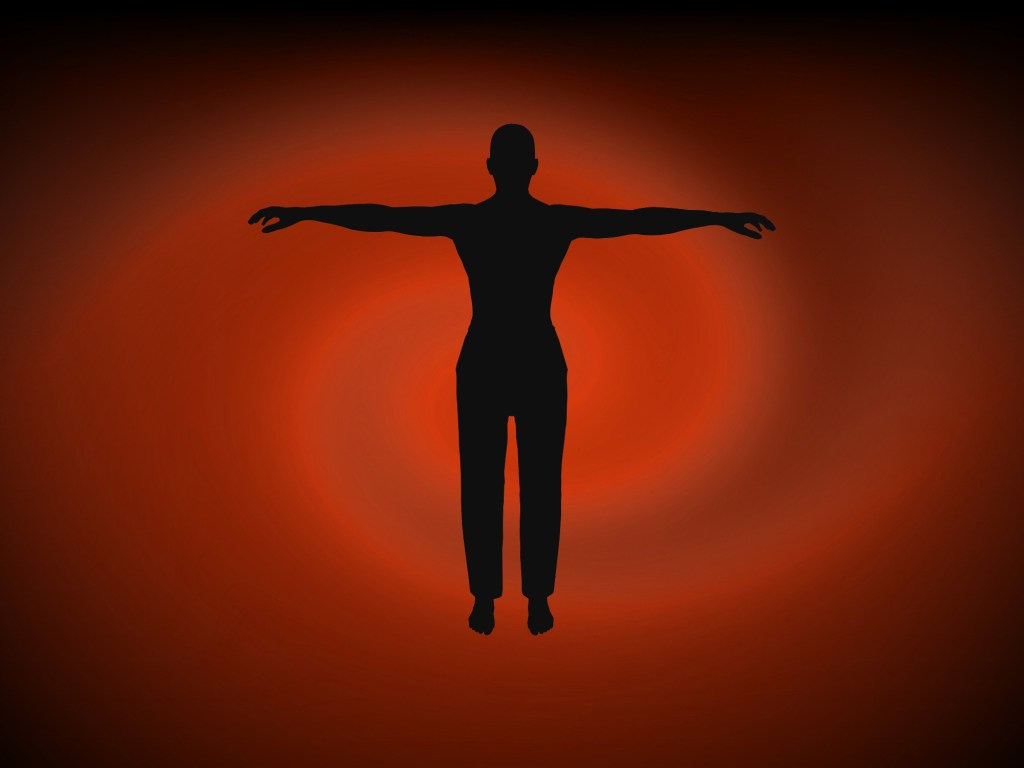 Man silhouette forming a cross