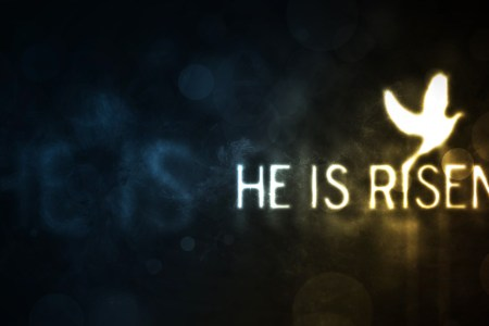 Glowing text (He is Risen) with a flying dove