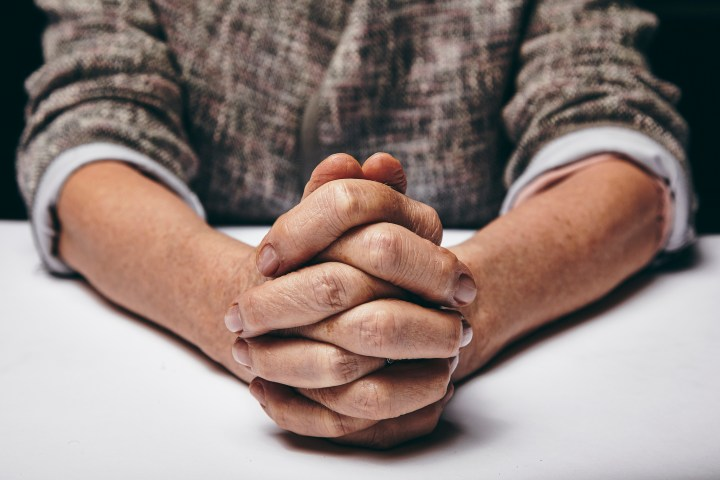 Photo of hands folded in prayer