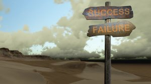 Signs pointing in opposite directions (success-failure)