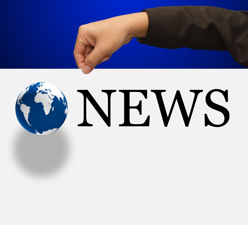 news concept with hand globe and paper board