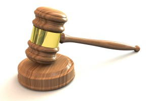 Gavel on stand for Family of rogue landlords