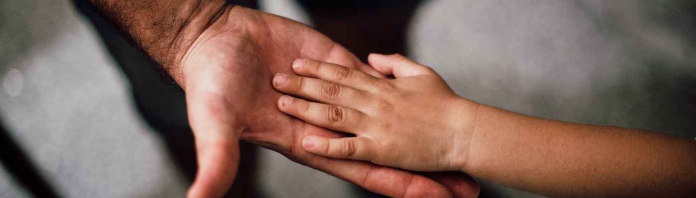 selective focus photography of child s hand