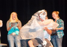 NSO director Mandy Tate hugs her son after they received a pie in the face during the events.