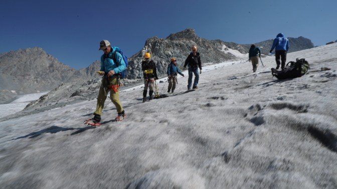CWC Faculty Darran Wells leads the Glacier Team in Ground Penetratind Data (GPR) data collection to assess ice depth. Photo by Kyle Nicholoff