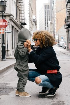 mother and child in street portrait Photo by Sai De Silva on Unsplash
