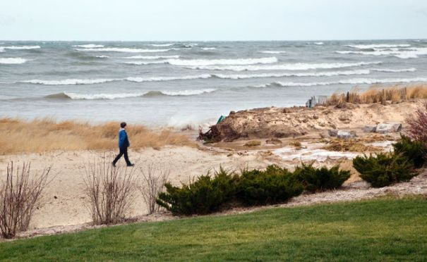 A resident walks along Ipperwash Beach (Postmedia Network file photo)