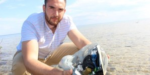 Narcis Bejtic, the Environment Network's head of business development, holds a mix of the type of plastic pollution found in Simcoe County's waterways, such as cigarette butts and coffee cup lids. - Ian Adams/Metroland