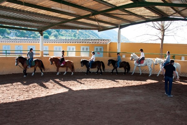 CHILDREN HAVING A LESSON IN OUR INDOOR SCHOOL
