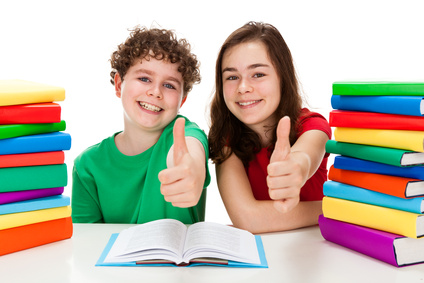 Girl and boy between piles of book isolated on white