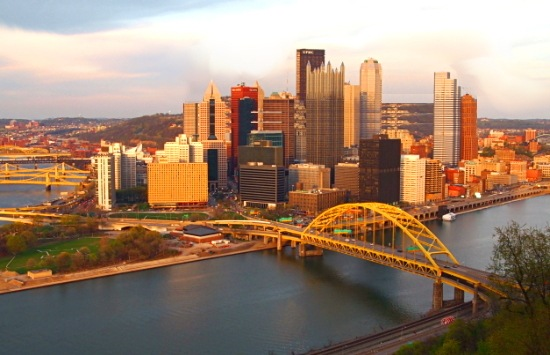 An image of the Pittsburgh Skyline on a sunny day showing the 3 rivers, not a cloud in the sky