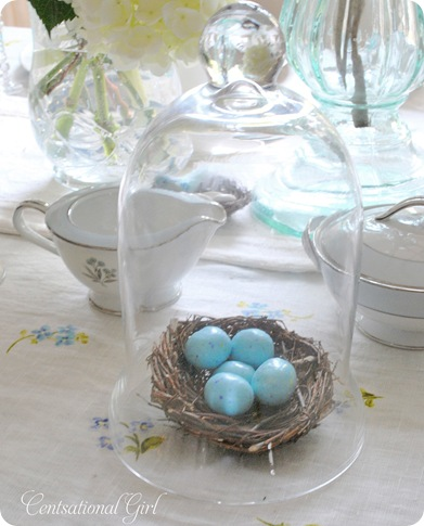 speckled candy eggs under glass