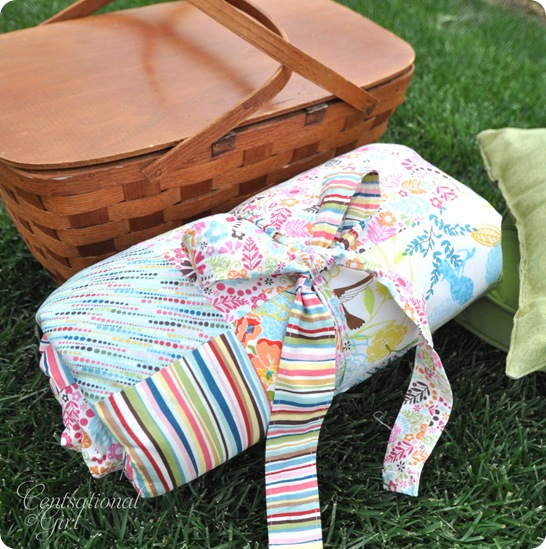cg patchwork picnic blanket tied up