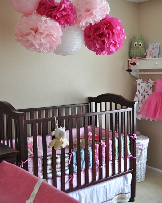 pink pom poms over crib