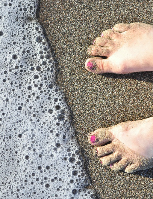 toes in beach sand
