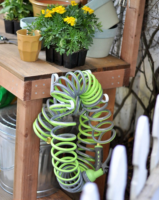 green hose on potting bench