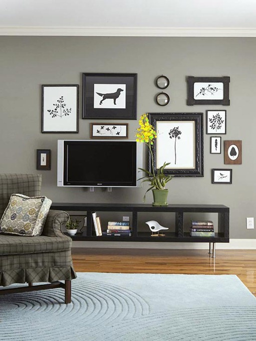 tv surrounded by art bhg