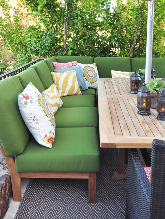 green outdoor sectional and table