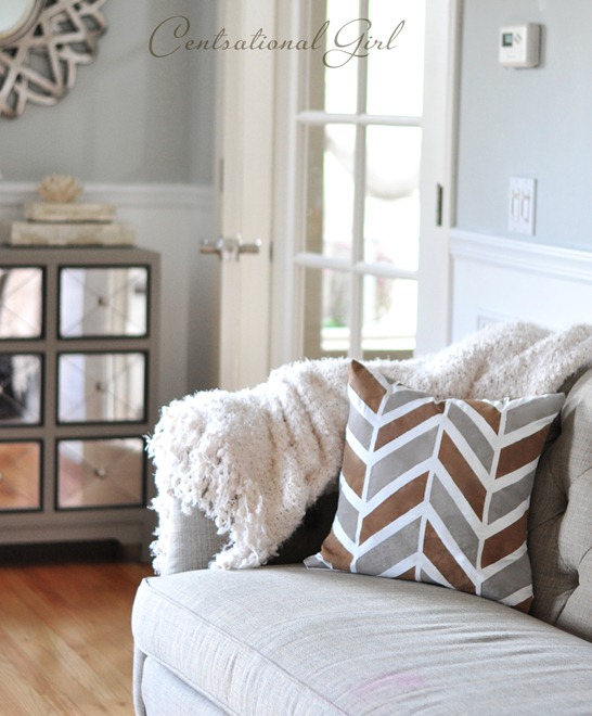 painted herrinbone pillow on tufted sofa cg