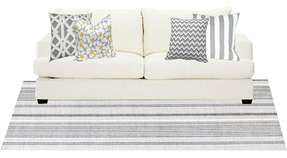 gray and white rug and pillows on sofa