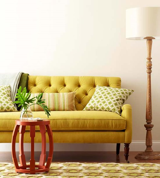 yellow tufted sofa