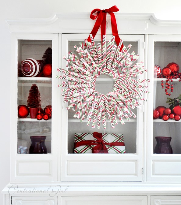 wrapping paper wreath on hutch