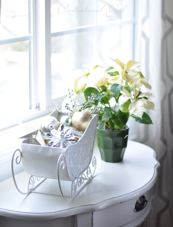 sleigh and potted poinsettia