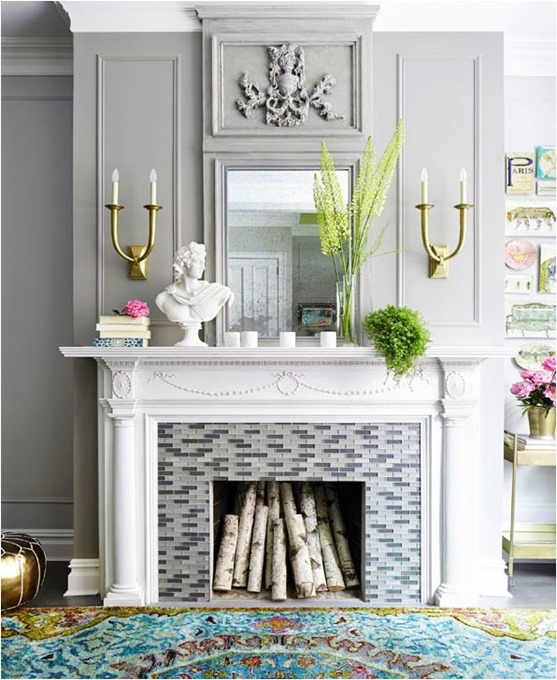 gray wainscot brass sconces over mantel