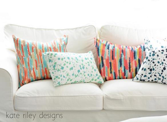 brushstrokes and splatter pillows on sofa