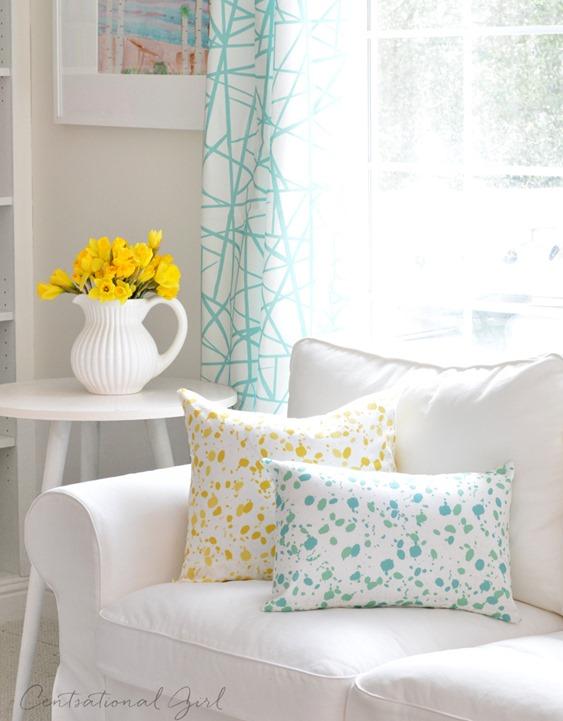 white sofa splatter pillows
