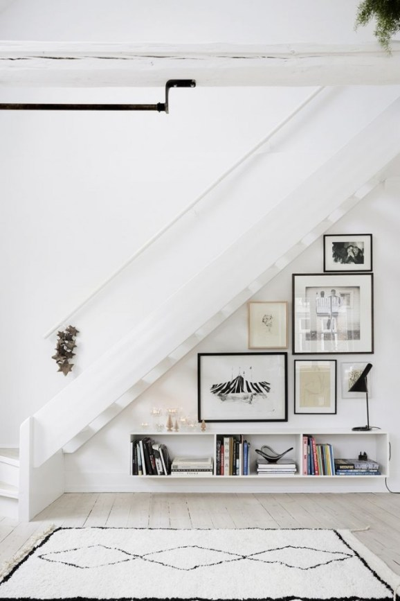 gallery wall under stairs
