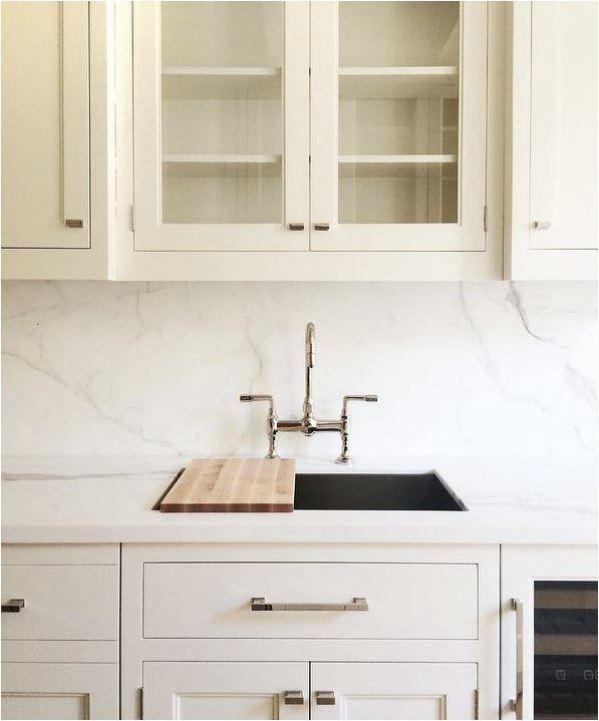 white cabinets dark sink