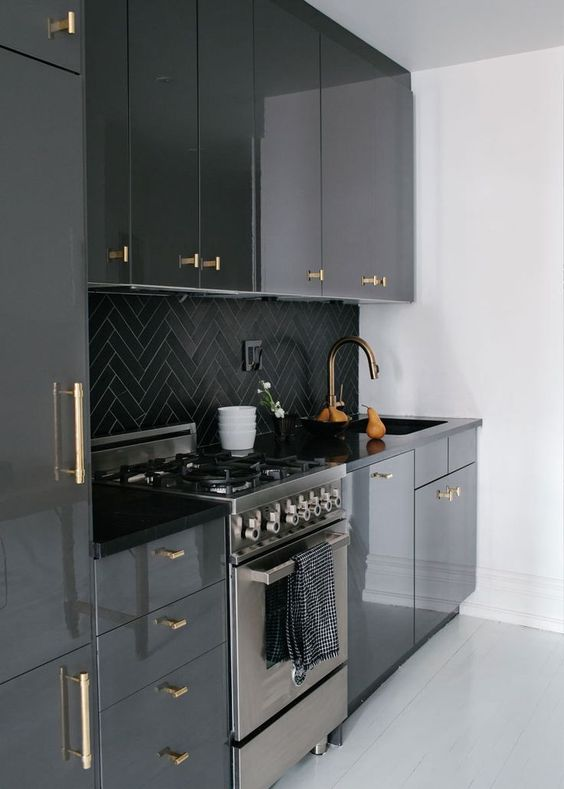 black and brass kitchen