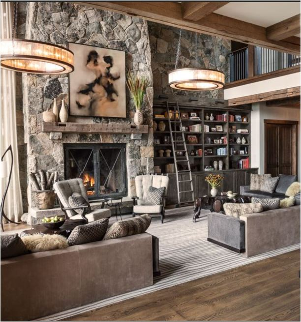 mountain home interior design. The diaconal plank walls add interest to the dining room  and stone fireplace timber beams are quintessential mountain home style Modern Mountain Homes Centsational Style