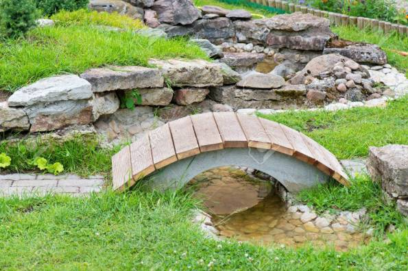 Alpine Garden With Bridge And Small Pond With Water Stock Photo inside 28+ How To Plant Up An Alpine Trough